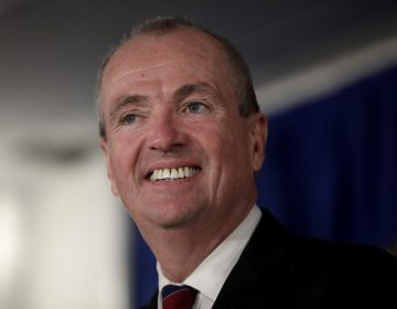 In this Jan. 16, 2018, file photo, New Jersey Gov. Phil Murphy speaks before signing the first executive order of his administration in Trenton, N.J. Democratic officials in some high-tax states are pushing legislation that would retain a federal tax break for state and local taxes, a deduction that was capped in the recent GOP tax overhaul. Murphy's office describes the push for a work-around to the new cap on local taxes as a matter of fairness, especially if many of the federal tax breaks expire as scheduled in 2027. (Julio Cortez/AP Photo, File)