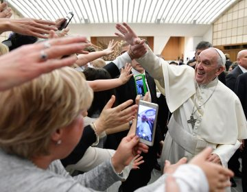 Pope Francis is cheered by faithful during an audience with health workers, in the Paul VI hall at the Vatican, Saturday, March 3, 2018. (L'Osservatore Romano/ANSA via AP)