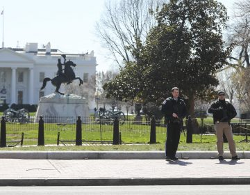 Law enforcement officers at Lafayette Park across from the White House in Washington, take up positions as they close the area to pedestrian traffic, Saturday, March 3, 2018.    The Secret Service says a man shot himself outside the White House, and medical personnel are on the scene. President Donald Trump is not at the White House,  he's in Florida, but is set to return later Saturday. The agency says in a Twitter post that there are no other reported injuries related to the incident.   (Pablo Martinez Monsivais/AP Photo)