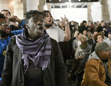 Student Philip Gregory, a Stadium Stompers member, protests during a Tuesday town hall meeting about the proposed $130 million, 30,000-seat stadium on Temple's campus. (Bastiaan Slabbers/for WHYY)