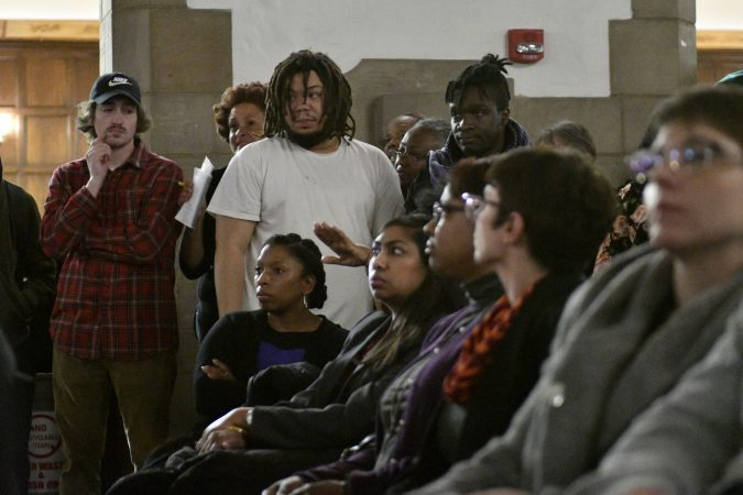 Community members, activist and students shut down a town hall meeting about the proposed $130 million, 35,000 seat stadium on Temple's campus, on Tuesday. (Bastiaan Slabbers/for WHYY)
