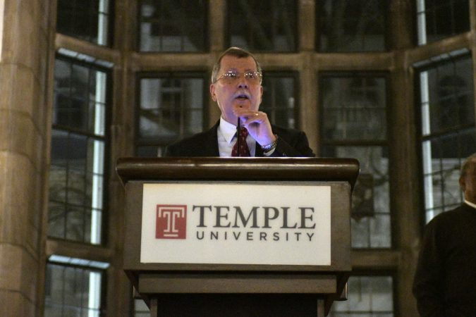 Temple University's President Richard M. Englert attempts to present plans for the proposed $130 million, 35,000 seat stadium on Temple's campus, on Tuesday. (Bastiaan Slabbers/for WHYY)