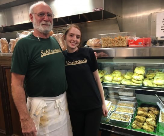 General Manager Russell Farer and Assistant Manager Shaina Robbins at Schlesinger's deli (Danielle Fox/WHYY)