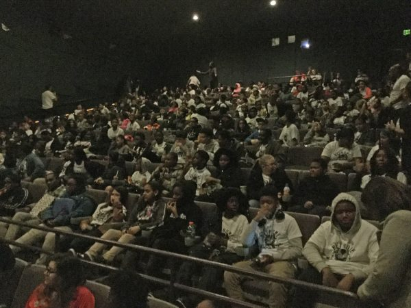 Students from Mary McLeod Bethune Elementary School wait in anticipation to see Black Panther. (Kyrie Greenberg/for WHYY)