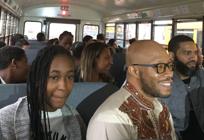 Seventh-grader Daiyannah Brown and Mr. Douglas are all smiles while on their way to see Black Panther. (Kyrie Greenberg/for WHYY)