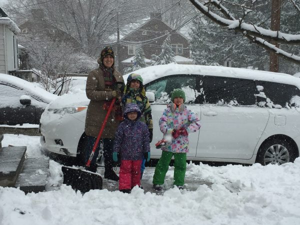 Shoveling is a family affair for the Bacchiocchis in Glenside, as mom Vivianna (from left) gets help from Massimo, Veronica and Sveva. (Nora O'Dowd/WHYY)