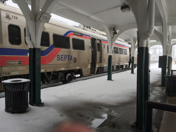 A SEPTA train slows to pick up passenger at the Glenside Train Station, but no one was waiting. (Nora O'Dowd/WHYY)