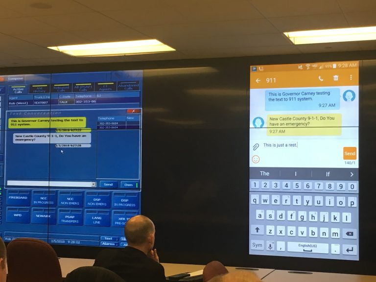 Delaware leaders unveil the state's new text-to-911 system at the New Castle County 911 center. (Mark Eichmann/WHYY)