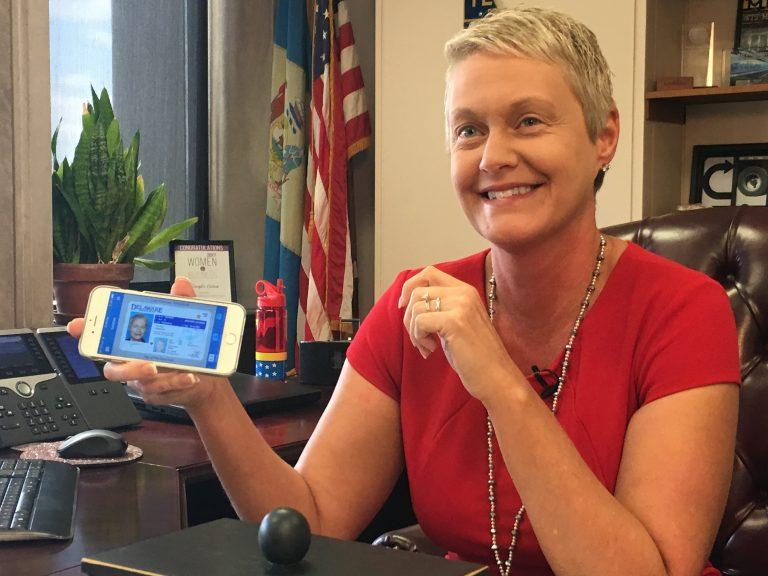 DelDOT Secretary Jennifer Cohan shows her digital driver's license on her cellphone. (Mark Eichmann/WHYY)