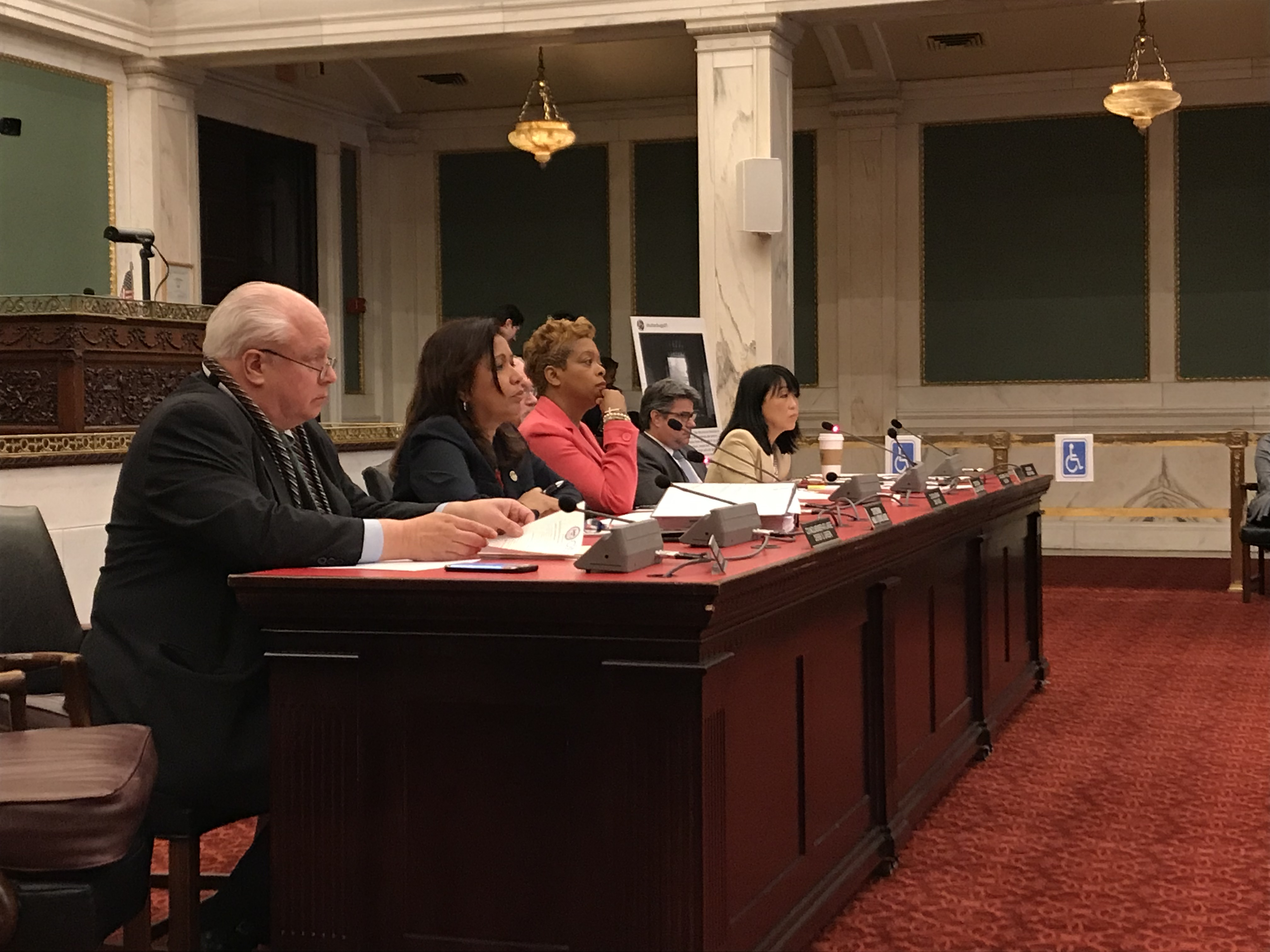 Council members on the Public Health & Human Services Committee listen to testimony at a hearing on the opioid crisis.
