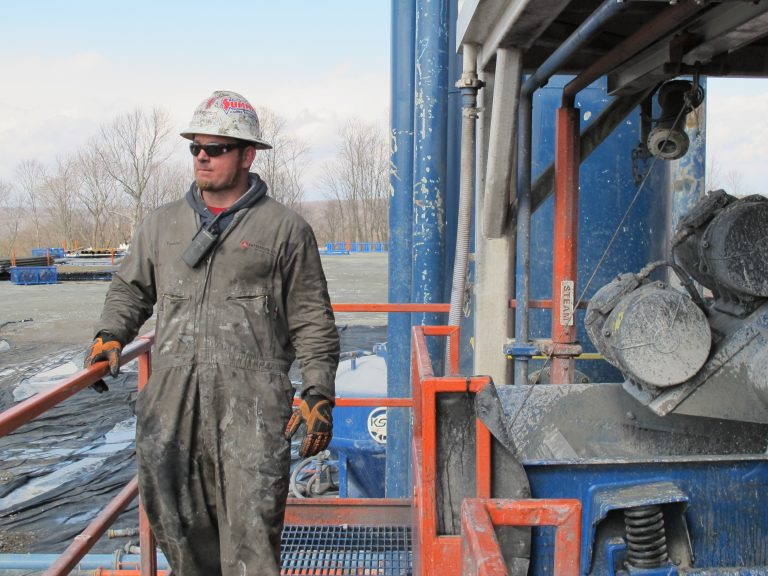 A natural gas worker on a rig in Susquehanna County in 2012. A StateImpact/Franklin & Marshall poll out Thursday shows a majority of registered voters, 69 percent, favor policies that would promote renewable wind and solar power over fossil fuel sources like coal and natural gas. (Susan Phillips/StateImpact Pennsylvania)