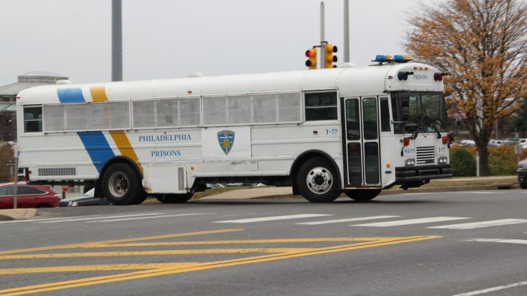 A bus leaves the correctional complex on State Road in Philadelphia. (Emma Lee/for NewsWorks)