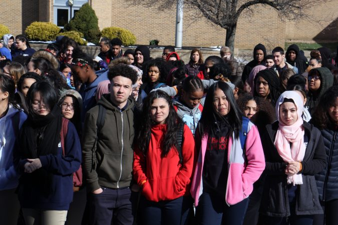 Pennsauken High students observe 17 seconds of silence in remembrance of the Parkland school shooting victims. About 600 students, nearly half the school, participated in the walkout.