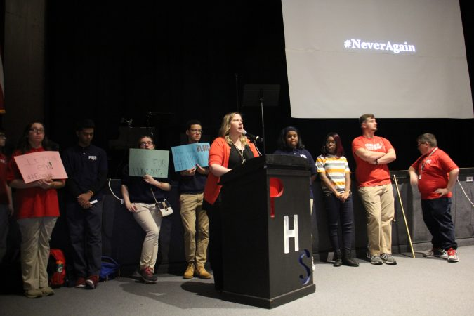 Pennsauken High School Vice Principal Caroline Steer and student leaders hold an assembly before the walkout to remember the victims of the Parkland school shooting.