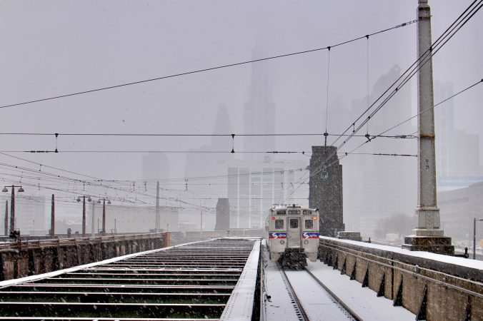A regional rail train departs 30th Street Station as the snow intensifies.