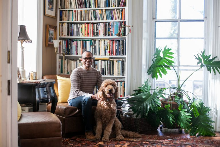James Earl Davis, a Professor of Urban Education at Temple University and his golden Doodle, Baldwin, pictured in his home in East Germantown.