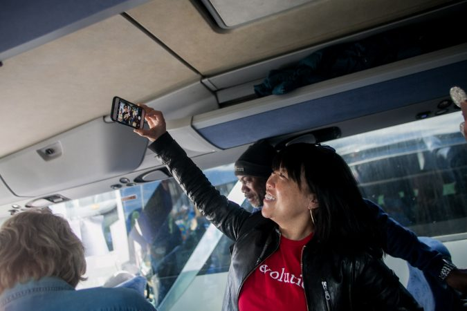 Philadelphia City Councilwoman Helen Gym takes a selfie with students, parents and teachers from Science Leadership Academy Beeber Campus on a bus bound for Washington D.C to attend the March for Our Lives. (Brad Larrison for WHYY)