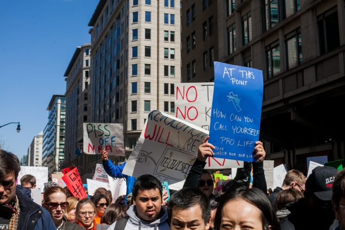 Demonstrators flood 12th Street in downtown Washington D.C during the March for Our Lives Saturday afternoon. (Brad Larrison for WHYY)