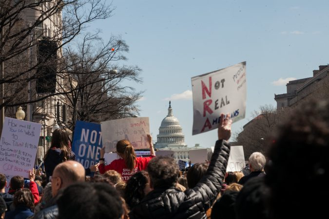 Demonstrators flood the streets downtown Washington D.C during the March for Our Lives Saturday afternoon. (Brad Larrison for WHYY)