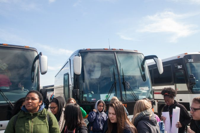 Students, parents and teachers from Science Leadership Academy Beeber Campus exit a bus after arriving in Washington D.C Saturday morning for the March for Our Lives. (Brad Larrison for WHYY)