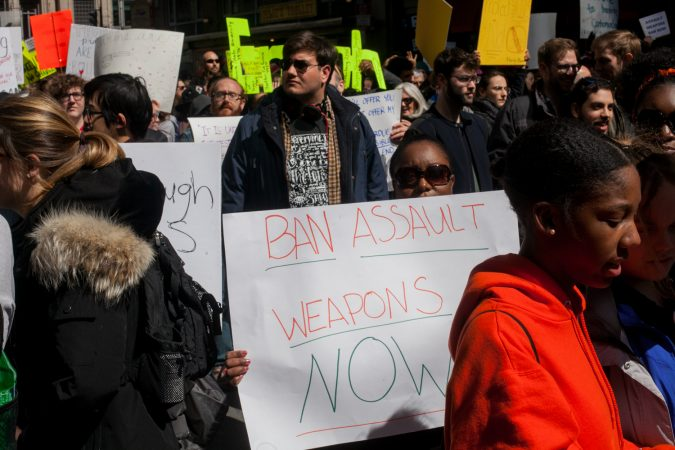 Stephanie Devaughn, whose daughter attends Science Leadership Academy Beeber Campus holds a sign calling for an assault weapons ban at the March for Our Lives in Washington D.C. (Brad Larrison for WHYY)