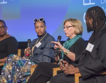 Marci Hamilton addresses questions from audience members during a panel discussion on workplace harassment and the #MeToo movement. From left are Annette John-Hall, Lynette Medley, Marci Hamilton and Michael O'Bryan. (Jonathan Wilson/for WHYY)