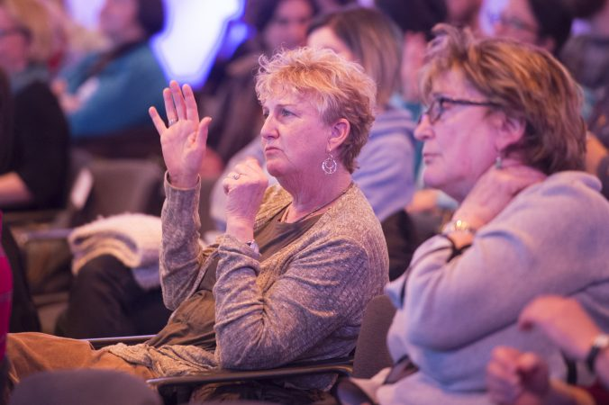 Audience members respond to questions from panelists on sexual harassment. (Jonathan Wilson for WHYY)