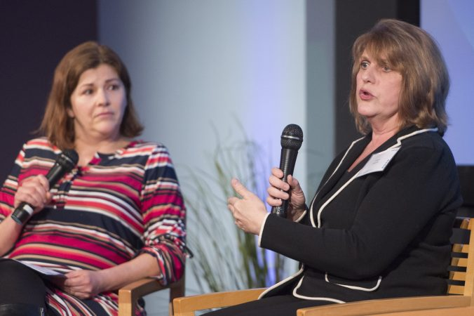 Alison DiFlorio, (right), explains how to respond to sexual harassment in the workplace. Maiken Scott, (left), listens. (Jonathan Wilson for WHYY)