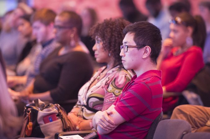 Audience members listen to a panel discussion. (Jonathan Wilson for WHYY)