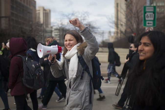 Olivia Sandom, Senior at Julia R. Masterman, leads a crowd of students down North Broad Street