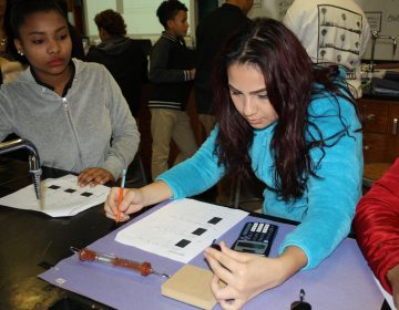 "Maria Ramirez, left, and Eunice Millán, both freshmen at Woodrow Wilson High School in Camden, New Jersey, are taking physics this year as part of a ""Physics First"" initiative to prepare more students for STEM careers. (Tara García Mathewson/The Hechinger Report)"