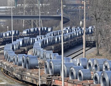 Steel coils sit on rail cars leaving the Thyssenkrupp steel factory in Duisburg, Germany