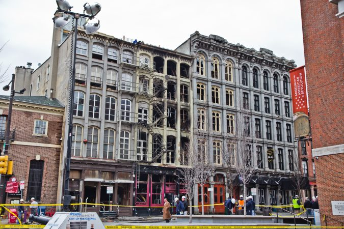 The area around the 4-alarm fire at 239 Chestnut Street which was contained around 7:30 a.m. this morning is closed off and being evaluated for further risk. (Kimberly Paynter/WHYY)