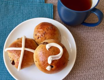 Decorating Easter buns with a variety of symbols is an inclusive way to share holiday food. (Kim Vukovich)
