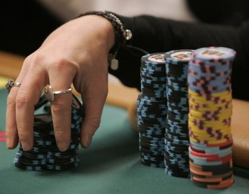 Professional poker player Annie Duke shuffles her chips during the US$50,000 buy-in HORSE event of World Series of Poker at the Rio hotel-casino in Las Vegas, Monday, June 25, 2007.  (AP Photo/Jae C. Hong)