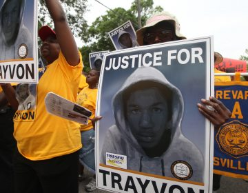 Protesters hold up signs in a march and rally for slain Florida teenager Trayvon Martin in Sanford, Fla., on March 31, 2012. (Julie Fletcher/AP)