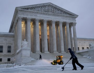 Workmen clear snow in front of the U.S. Supreme Court earlier this month. (J. Scott Applewhite/AP)