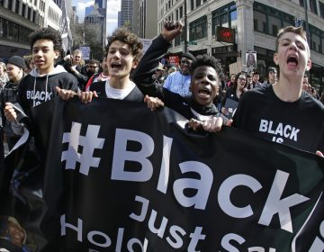 Young protesters take part in a Black Lives Matter march