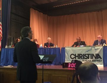 Gov. John Carney appeared before the Christina School District board in February and made his pitch for approval of the partnership. The Memorandum of Understanding to consolidate five schools passed 4 to 2 with one abstention. (Cris Barrish/WHYY)