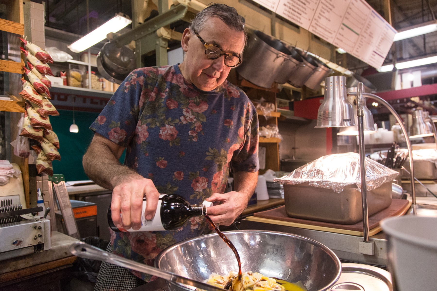 Around 5:30 a.m., co-owner Andy Wash joins the preparations, beginning his day with his four-cheese kugel, which is a sweet, cheese, noodle dish which has its roots in old Jewish cooking.