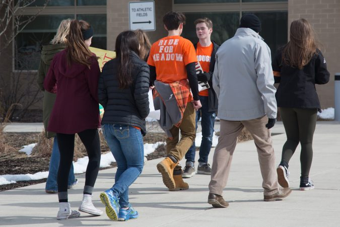 Student organizers walk back into school after a successful walkout and rally