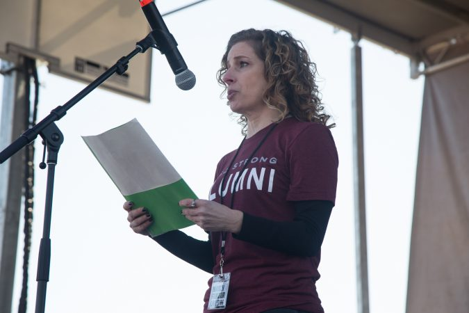 Marjory Stoneman Douglas High School alumna, Rebeca Salus, talks to the crowd gathered at the Philadelphia March for Our Lives, March 24, 2018. (Emily Cohen for WHYY)