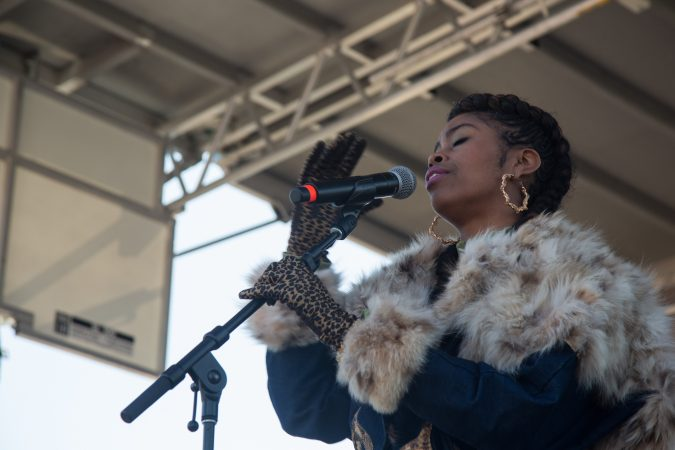Suzann Christine, a Philadelphia musician, sings to the crowd gathered at the Philadelphia March for Our Lives, March 24, 2018. (Emily Cohen for WHYY)
