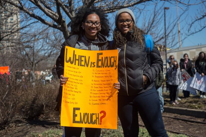 Demitria Mercer came over from New Jersey to march with her daughter Re'Ann, 18, who is a freshman at Temple University. (Emily Cohen for WHYY)