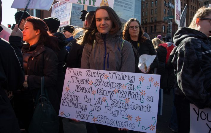 Lila Smith, 14, from New Jersey, takes a stand at the Philadelphia March for Our Lives, March 24, 2018. (Emily Cohen for WHYY)