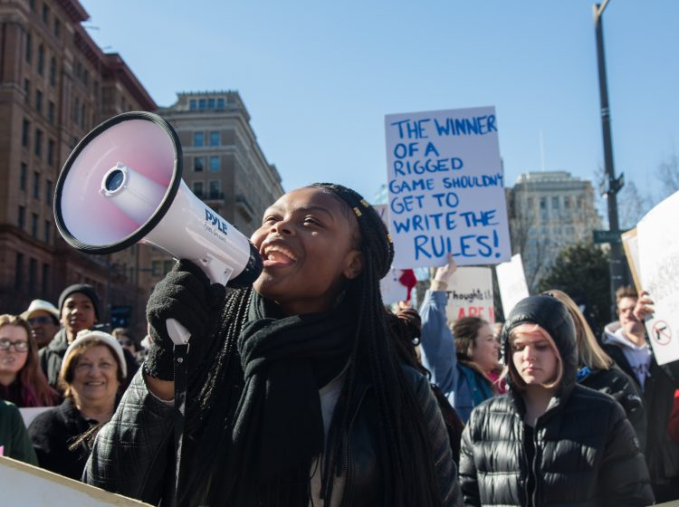 Princess Rahman, 18, leads chants at the beginning of the Philadelphia March for Our Lives, March 24, 2018. (Emily Cohen for WHYY)