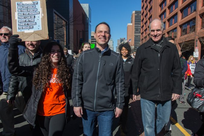 Pennsylvania Attorney General Josh Shapiro, (center), marches with his daughter, Sophia, 16, and Senator Bob Casey at the Philadelphia March for Our Lives, March 24, 2018. (Emily Cohen for WHYY)