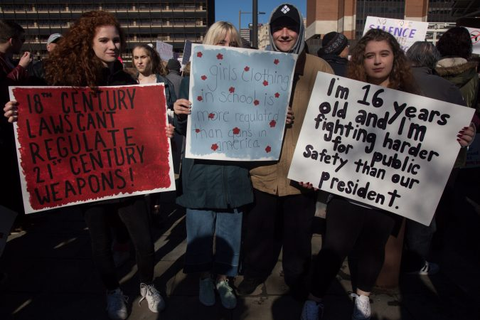 Sophomores from Springfield High School in Springfield, Pa., Kyra Kucirka, 16; Juliana Bater, 15; Ethan Graci, 16; and Deborah Persico, 16; join their peers and fellow citizens as they march for gun control and against gun violence at the Philadelphia March for Our Lives, March 24, 2018. (Emily Cohen for WHYY)