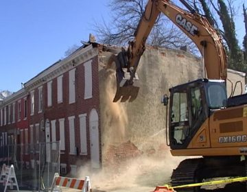 Demolition work begins on some abandoned homes on Bennett St. in Wilmington. (Dan Rosenthal/WHYY)