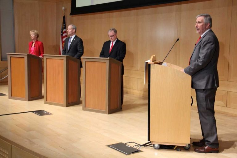 Pennsylvania GOP gubernatorial candidates debate at the National Constitution Center. They are (from left) Laura Ellsworth, Paul Mango, and state Sen. Scott Wagner. WHYY senior reporter Dave Davies (right) was moderator, (Emma Lee/WHYY)